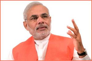 Le premier ministre: Narendra Modi démonétise les billets de 500 et 1000 roupies et fait grimper le cours de l'or en Inde